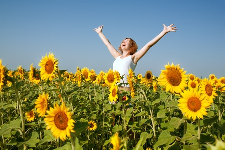 happy woman in sunflower field photo