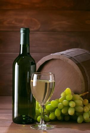 bottle of vine on  wooden background Stock Photo - 13339561