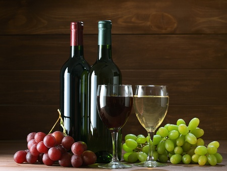 bottle of vine on  wooden background Stock Photo - 13339557