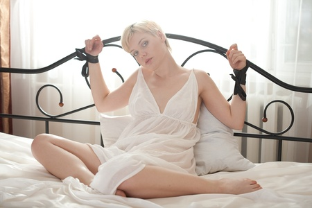 woman bondage on the bed Stock Photo - 13411222