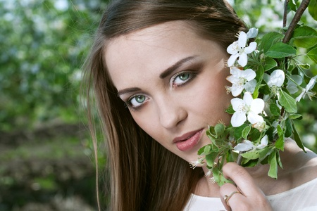 beauty young woman in the apple garden photo