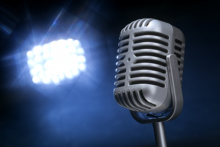 retro microphone with spotlight and rays  photo