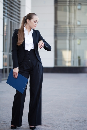 portrait of a young business woman look at clock Stock Photo - 14056741