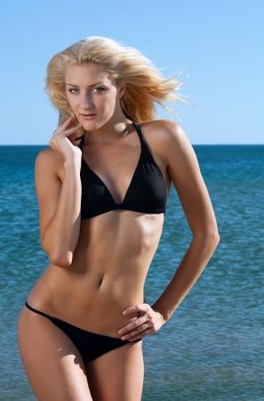 body curve: beauty sexy woman on beach in bikini Stock Photo