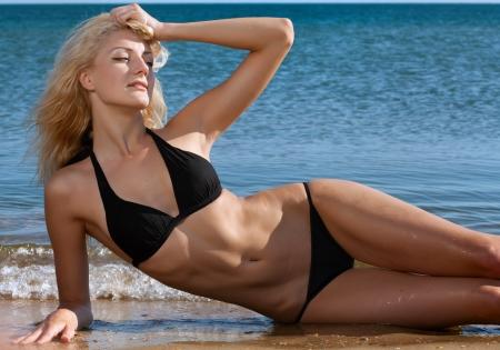 blonde bikini: beauty sexy woman on beach in bikini Stock Photo