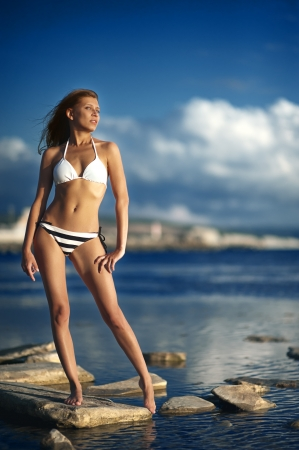 woman in bikini  at sea Stock Photo - 16011441