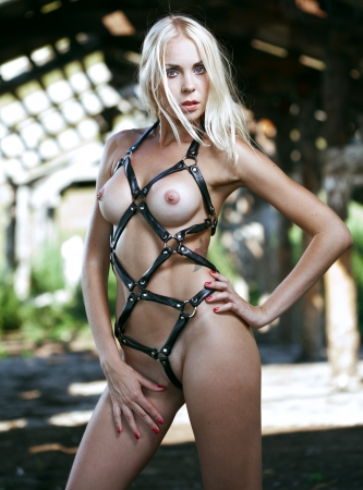 nude: Beautiful girl in a role-based outfit in an old barn Stock Photo