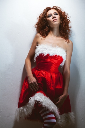 fatigue redheaded mrs santa clause Stock Photo - 16119112