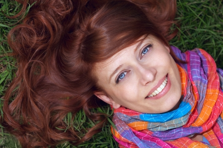 beauty redhaired woman lie on green grass Stock Photo - 17507054