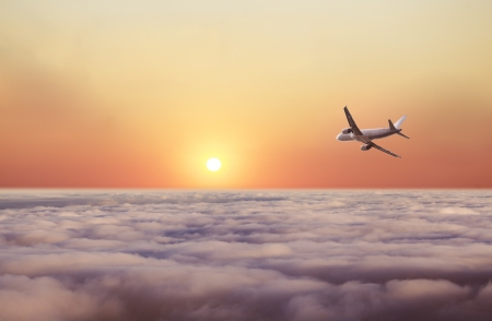 above the clouds: airplane fly over clouds and sunset