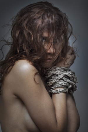 redhaired woman bondage on gray background Stock Photo - 17507082