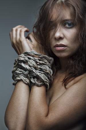 redhaired woman bondage on gray background Stock Photo - 17507071