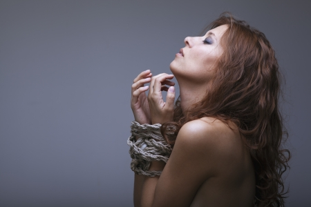 beauty redhaired woman bondage rope Stock Photo - 17867021