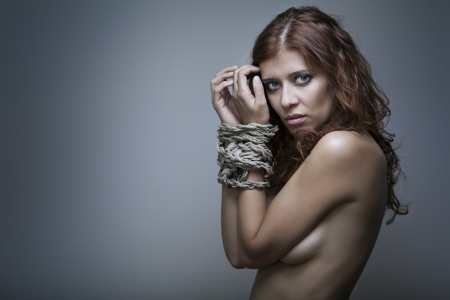 redhaired woman bondage on gray background Stock Photo - 17867000