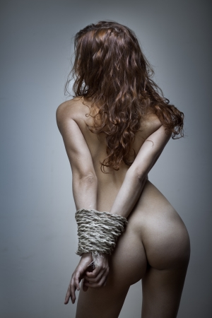redhaired woman bondage on gray background Stock Photo - 17507104