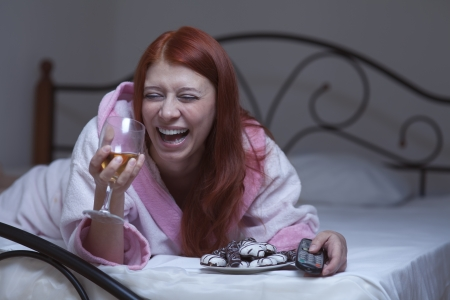hysterical: redhead woman in hysterical depression watch tv with vine Stock Photo