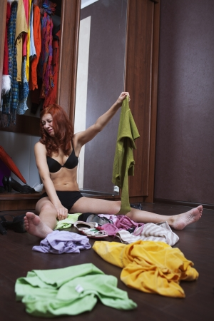 woman can not choose what to wear Stock Photo - 17934968