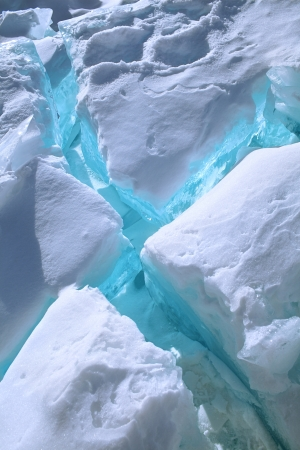 cracks in ice: blue cracks in ice with snow