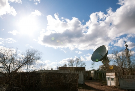 airwaves: view of satellite dish with sun Stock Photo