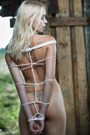 beauty woman bondage in wooden room photo