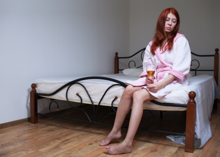 drunk woman: Drunk woman with alcohol in depression Stock Photo