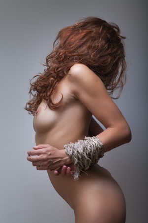 redhaired woman bondage on gray background Stock Photo - 20561293