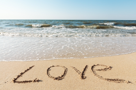 sea beach with sand word love photo