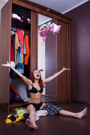 woman throwing clothes in the air photo
