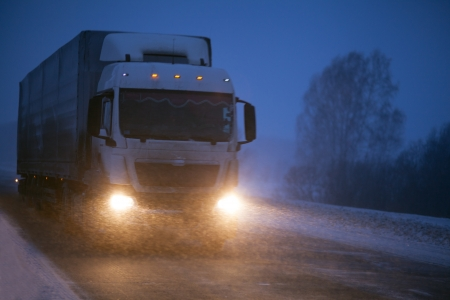 Winter freight transportation by truck photo