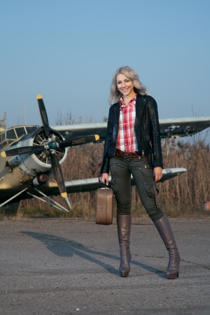 beauty blonde woman with plane photo
