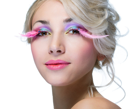 pink lips: beauty woman with pink eyelashes over white background Stock Photo