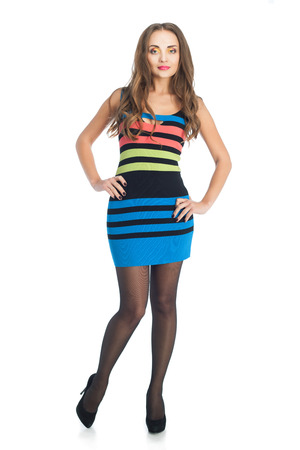 beauty woman in colored stripe dress over white background Stock Photo - 24369309