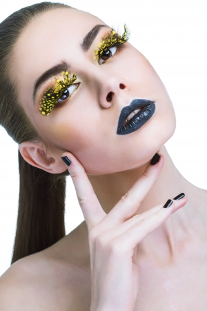false teeth: beauty woman with long yellow lashes and black lips over white background