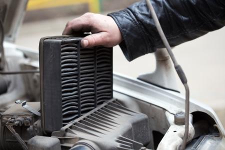 replacing the air filter, car repair  photo