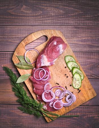 Sliced raw meat pork on board  photo