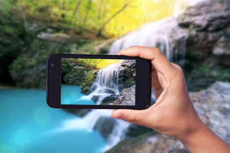 photo shooting on smartphone in tourist journey photo