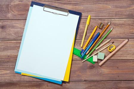 drawing table:  stationery objects on wooden background