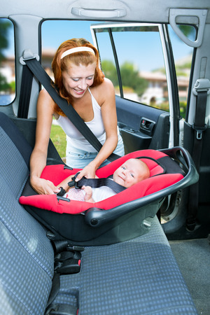 woman baby seats in the car seat photo