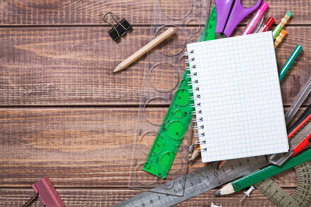 stationery objects on wooden background photo