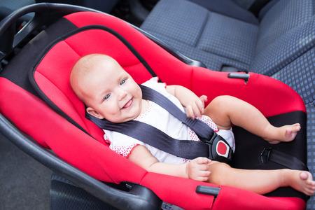 車の座席に女性ベビーシート 写真素材