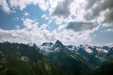 dombay: Mountain under blue sky with clouds