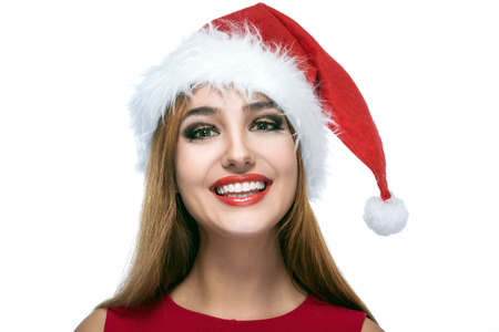 christmas happy woman in santa red hat over white background photo