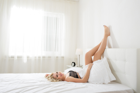 woman laying: Beauty blonde woman in white bed