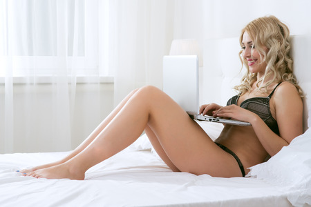 Beauty blonde woman in white bed