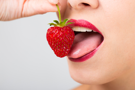woman mouth with strawberry Stock Photo