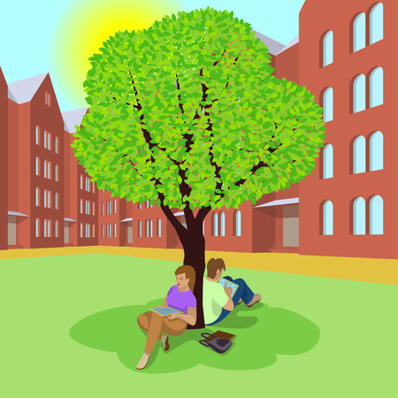 Students sitting under the tree and using the tablets. Couple resting in the shade of a tree. Campus in the spring. Sun is shining. Isolated background.