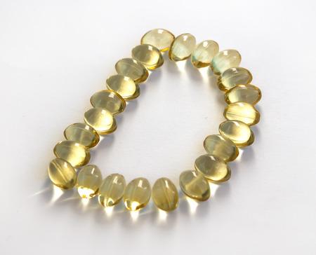 Sunshine Vitamin D letter on white background photo