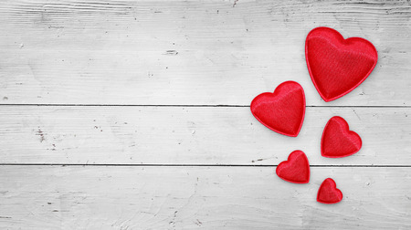 Red hearts on wood Valentines day background photo