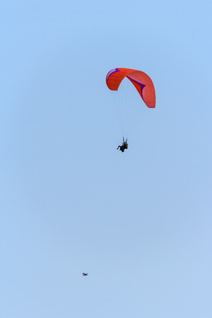 high flier: Higher than the birds, paragliding in the sky Stock Photo