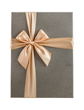 paper texture: Isolated present with beautiful gold ribbon, top view Stock Photo